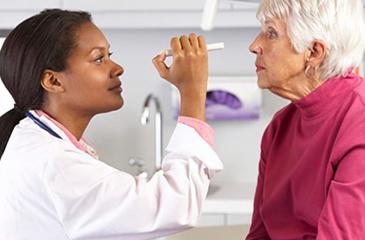 Patient receiving eye exam from eye doctor