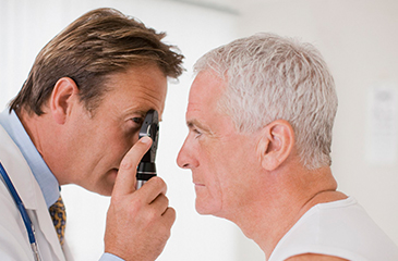 Patient getting his eyes examined by eye doctor